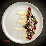 Gnocchi alle ortiche, pancetta croccante, pomodorini confit e ricotta salata