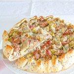 Torta salata con salsiccia, carciofi e provola